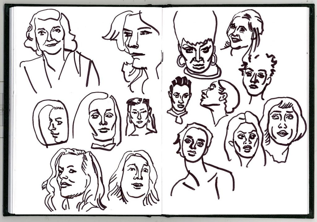 Faces of women drawn in pen and ink.